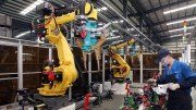 Industrial robots at work in Kushan Daya Auto Parts Company. SCMP Pictures