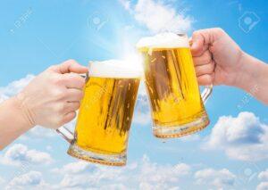 70365422-clinking-beer-glasses-on-sky-background.jpg